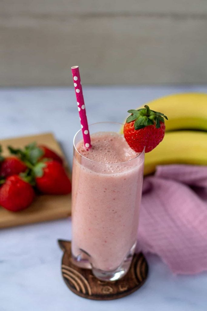 Strawberry Banana Smoothie with pink straw