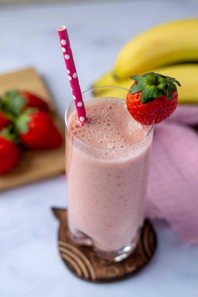 Strawberry Banana Smoothie with strawberry on rim