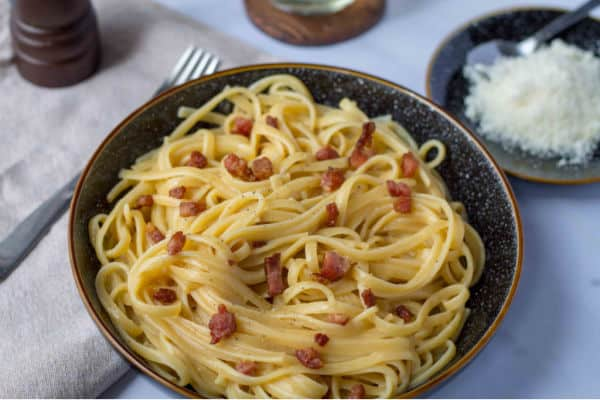 Bowl of Bacon Carbonara with cheese