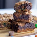 Monster Cookie Bars in a stack with a bite