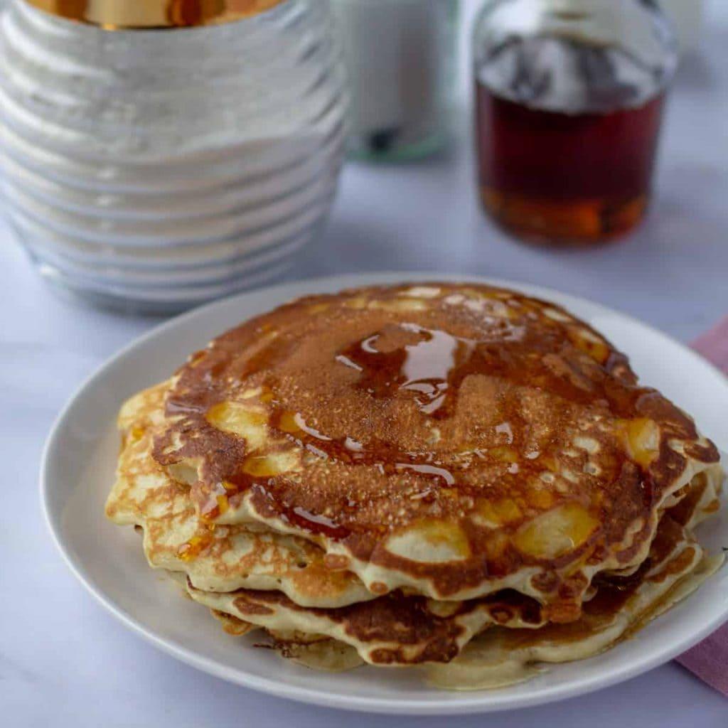 Homemade Vanilla Pancake Mix plus pancakes on a white plate
