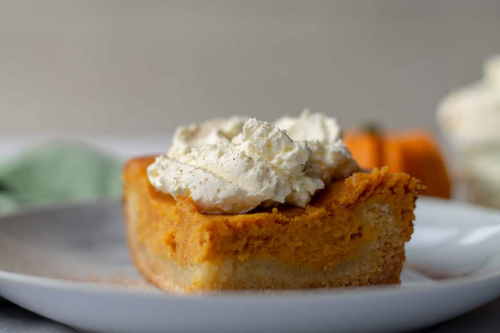 Pumpkin Spice Gooey Butter Cake slice with whipped cream