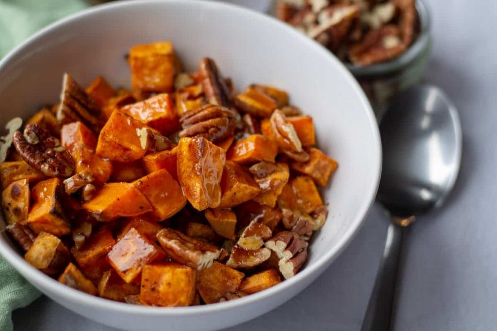 Roasted Sweet Potatoes with Spiced Maple Butter with a spoon