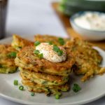Zuchinni & Potato Pancakes with sour cream and green onions