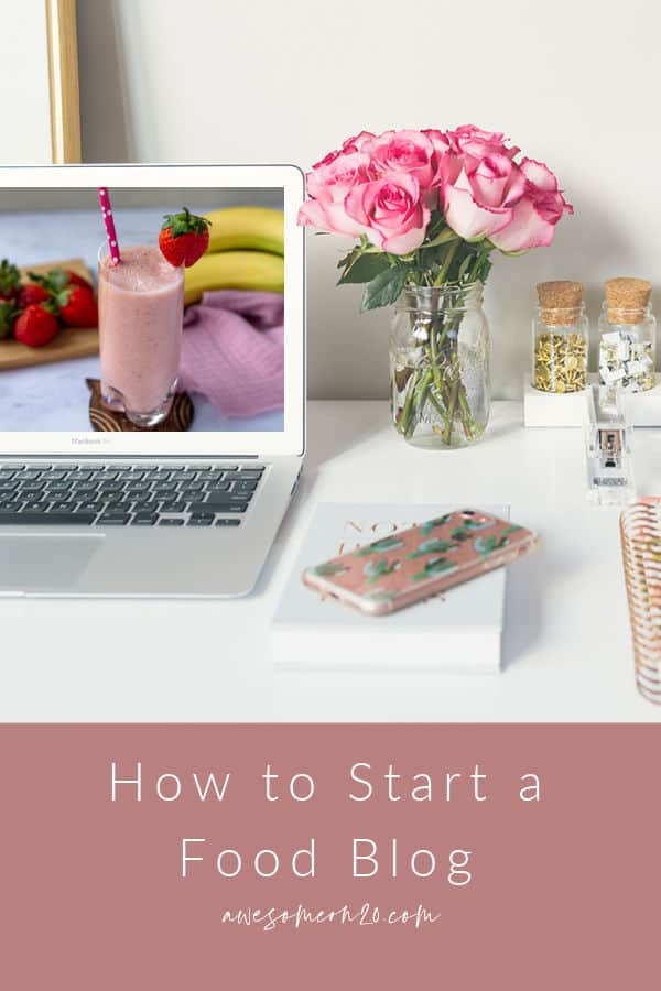 How to Start a Food Blog with laptop on desk with pink roses, phone, and notebook