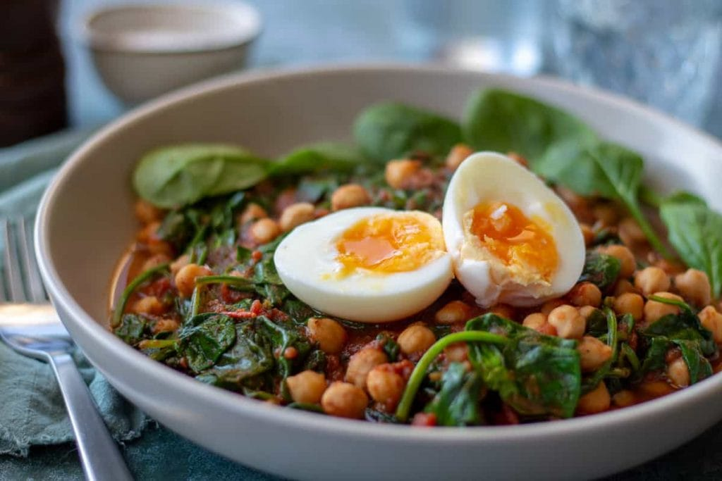 Chickpea & Spinach Curry close up with soft boiled egg
