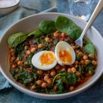 Chickpea & Spinach Curry in a bowl with egg