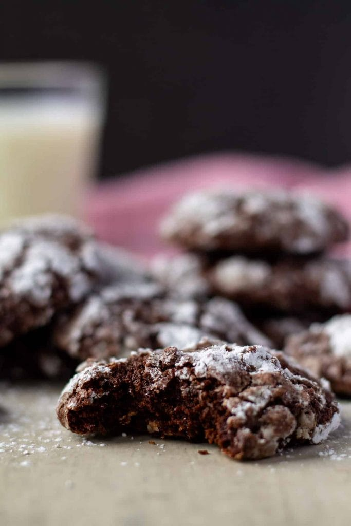Chocolate Crinkle Cookies with a bite taken