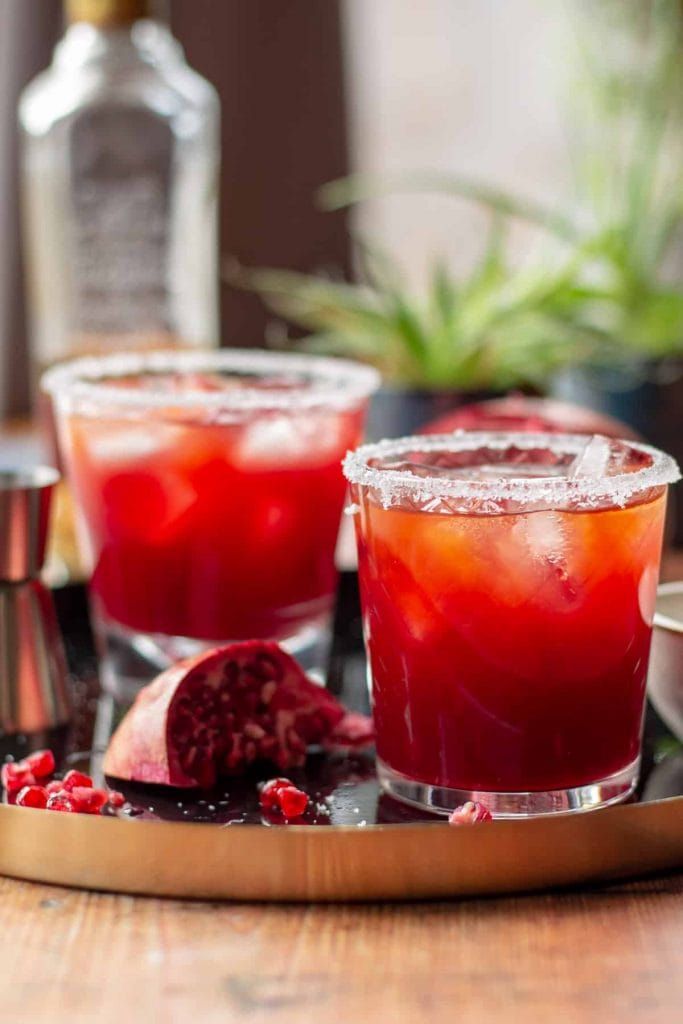 Pomegranate Margarita with a salt rim and pomegranate seeds