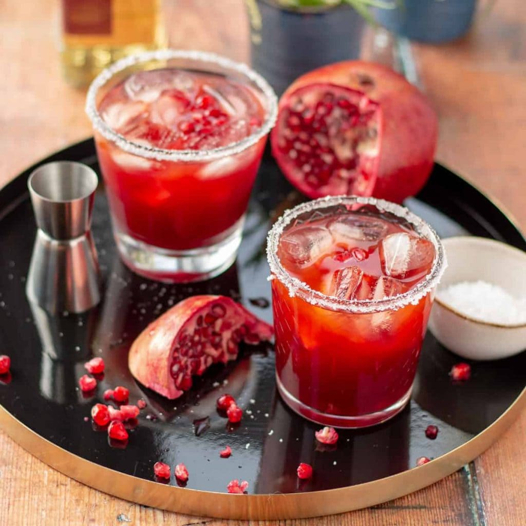 Two Pomegranate Margaritas in short glasses