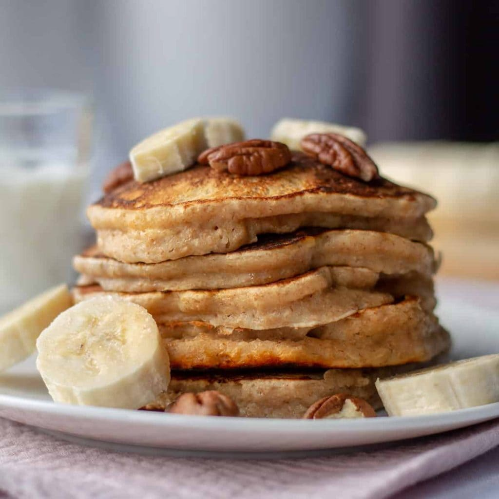 Whole Wheat Pancakes stacked with bananas and pecans