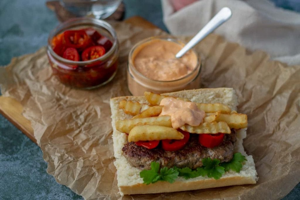 Mitraillette with red pepper mayo, fries, jalapenos, and lamb burger