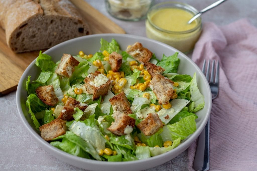 Caesar Salad with Brown Butter Croutons and a loaf of bread