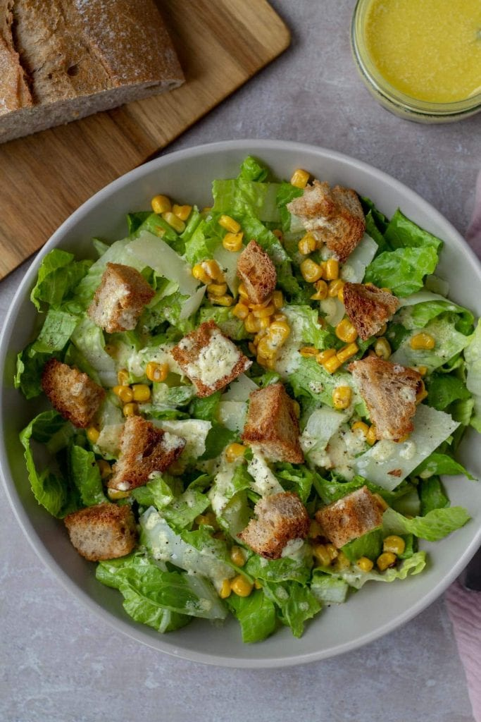 Caesar Salad with Brown Butter Croutons in a gray bowl