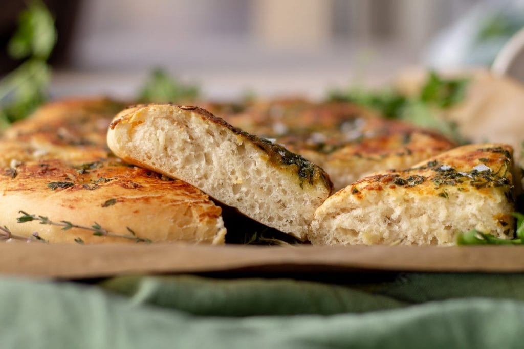 Garlic & Herb Focaccia Bread pieces close up