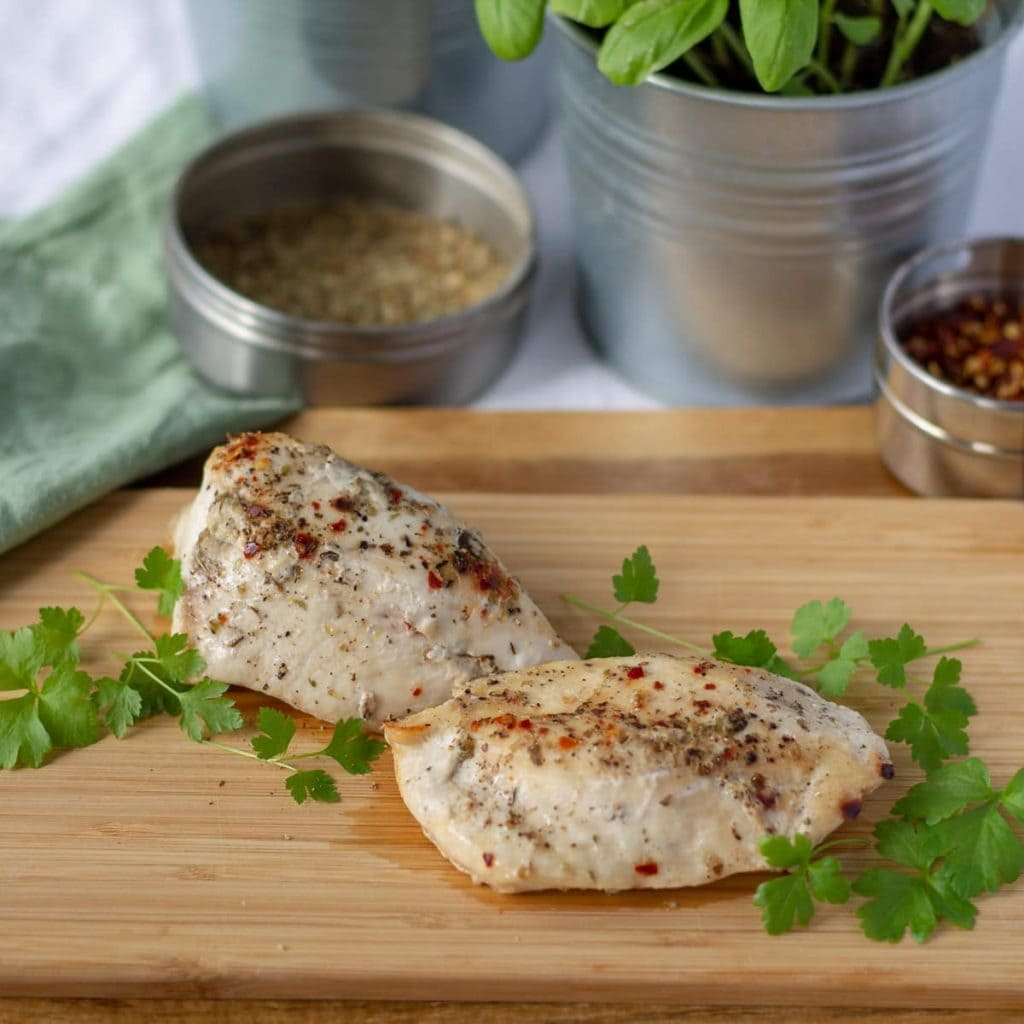 How to Cook Frozen Chicken - chicken breasts on a board