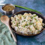 Za'atar Potato Salad in a black bowl
