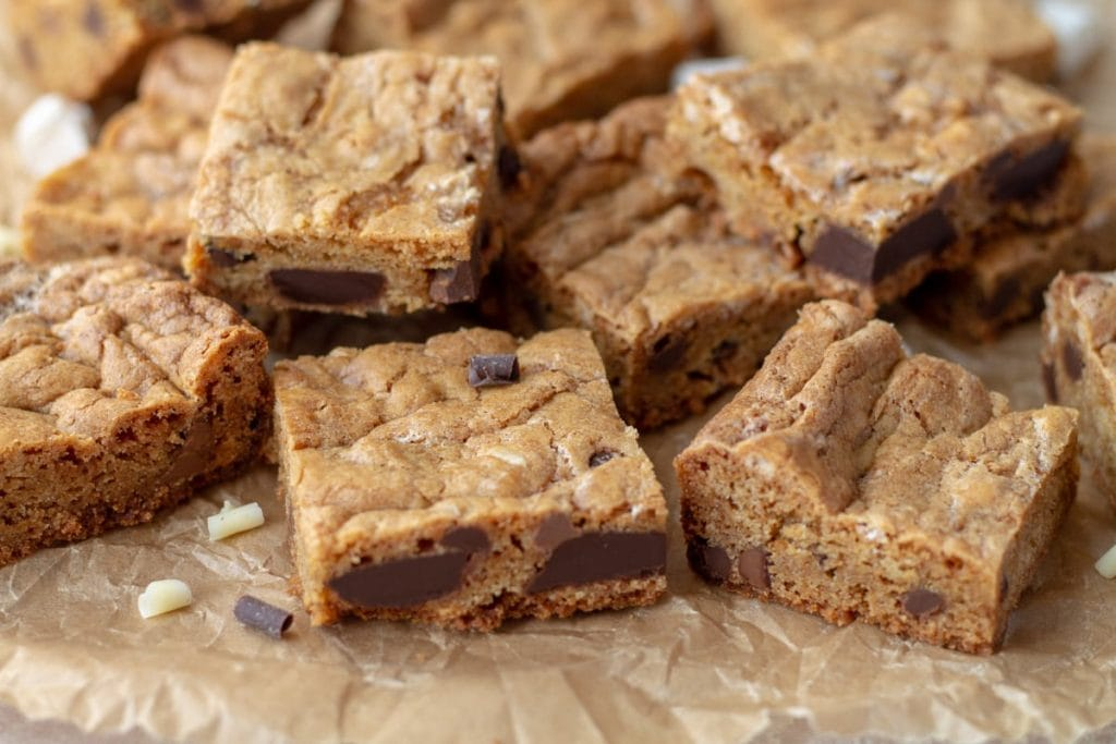 Chewy Chocolate Chip Cookie Bars on parchment