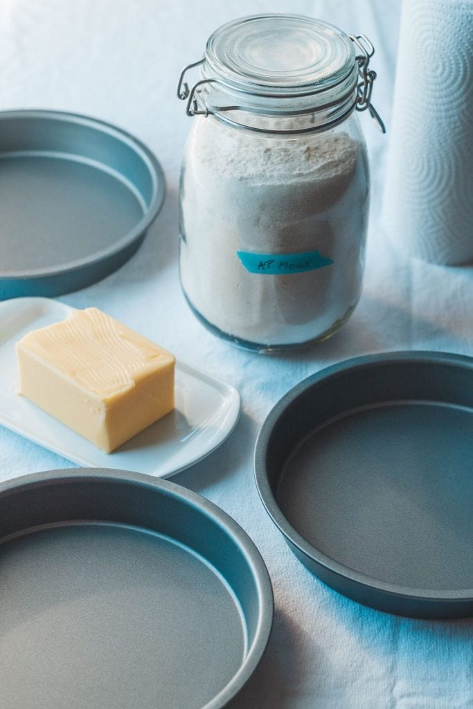 three round cake pans and flour and butter