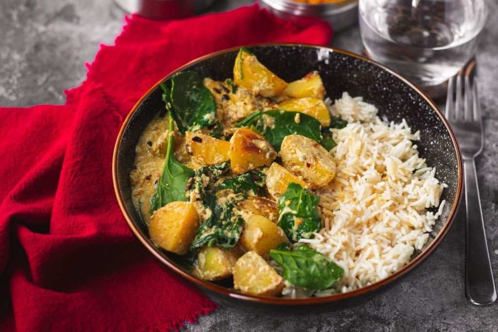 Potato & Spinach Curry and a red napkin