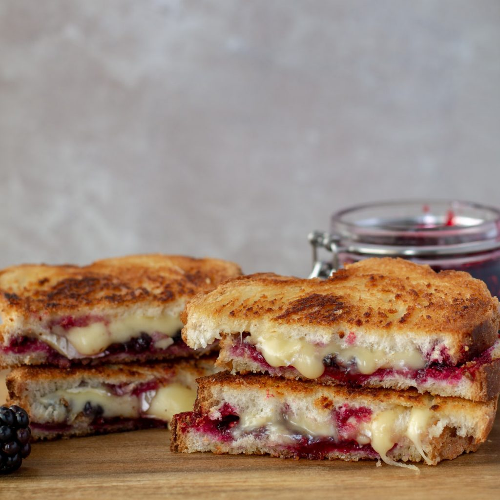 Brie & Blackberry Grilled Cheese cut in half