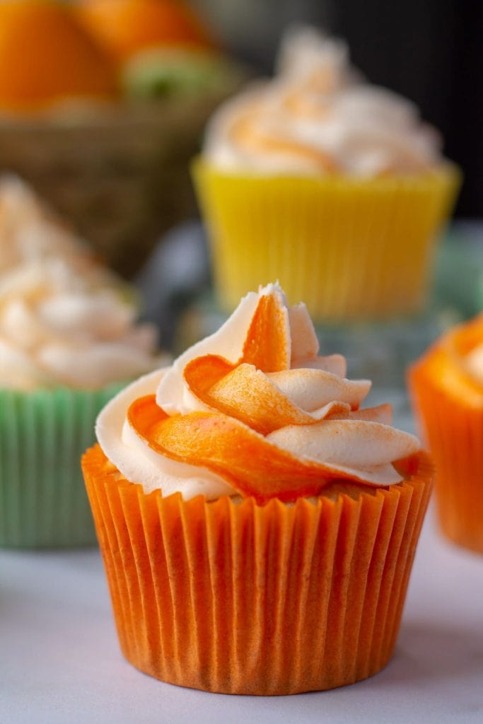 Citrus Cocktail Cupcakes with orange striped frosting