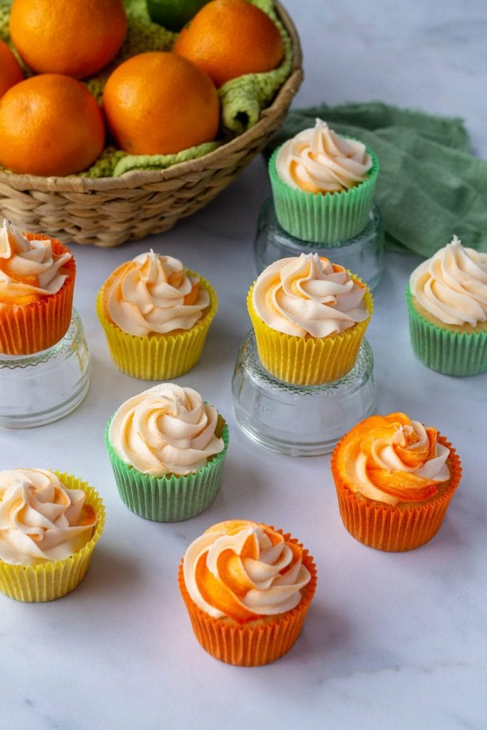 Citrus Cocktail Cupcakes with a basket of oranges