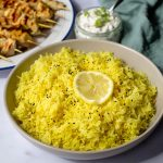 Lemon Rice with nigella seeds in a serving bowl