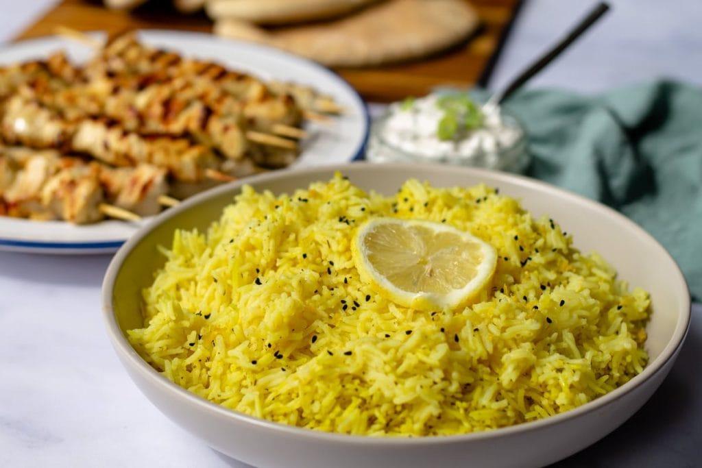 Lemon Rice in a serving bowl with a lemon slice