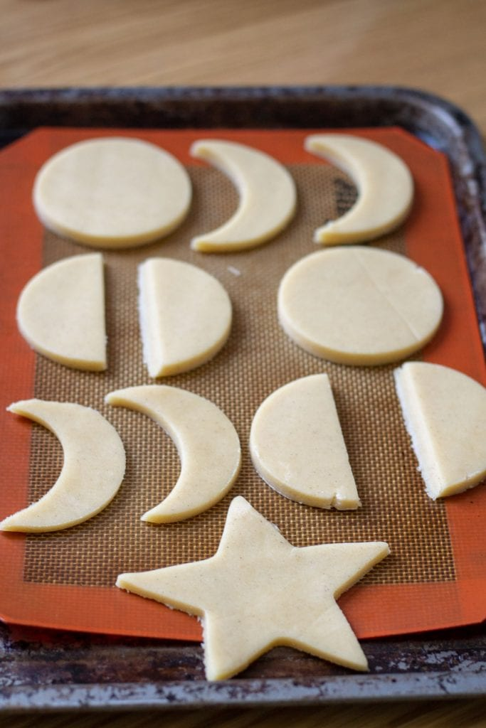 unbaked sugar cookies on a baking sheet