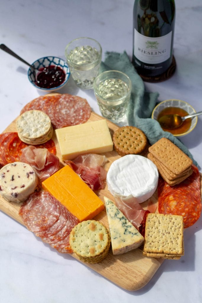 an epic cheeseboard with wine