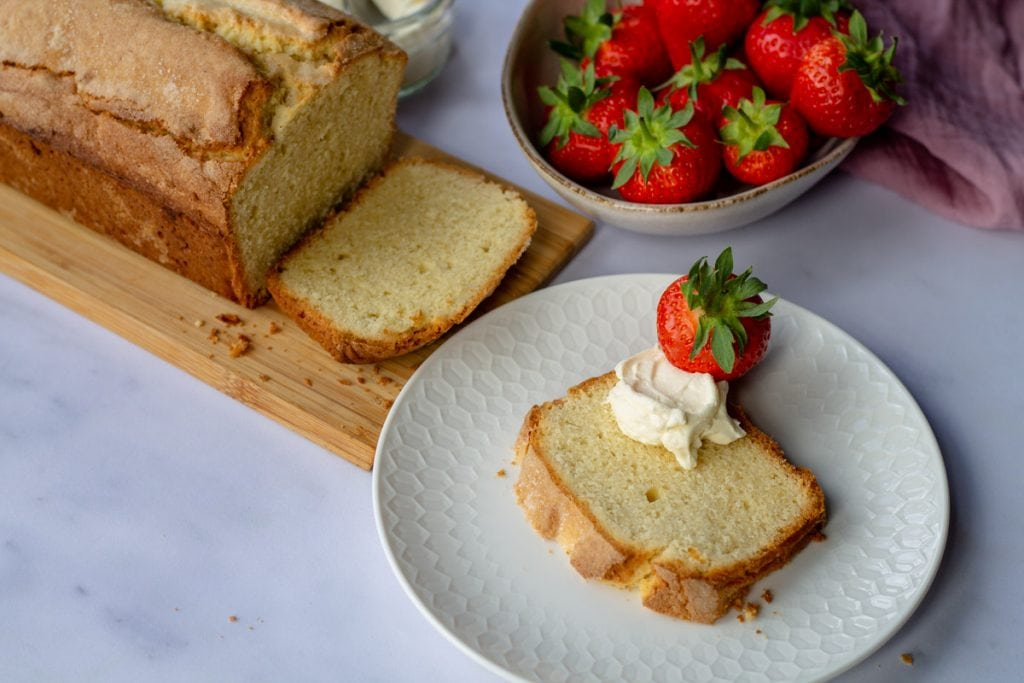 Madeira Cake slice with strawberry and whole loaf