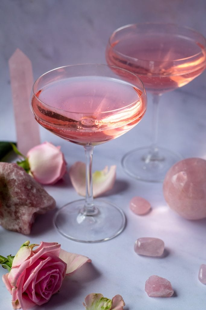 Rose Quartz Cocktail surrounded by crystals