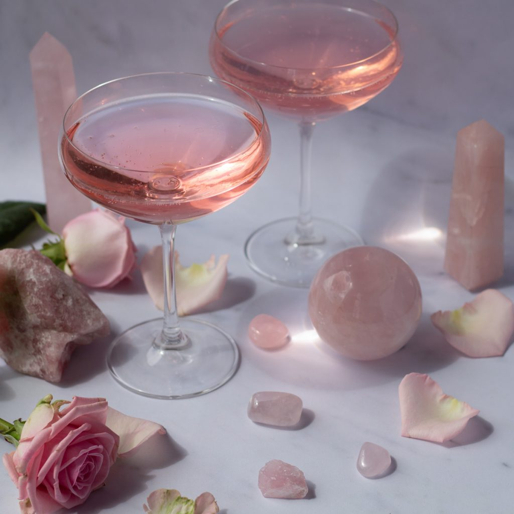 Rose Quartz Cocktail in coupe glasses with pink roses