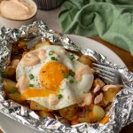 Bacon Egg & Cheese Grilled Potatoes with green linen