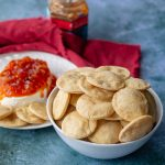 Homemade Spice Crackers in a white bowl and red linen