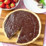 Chocolate Amaretto Tart with a slice removed