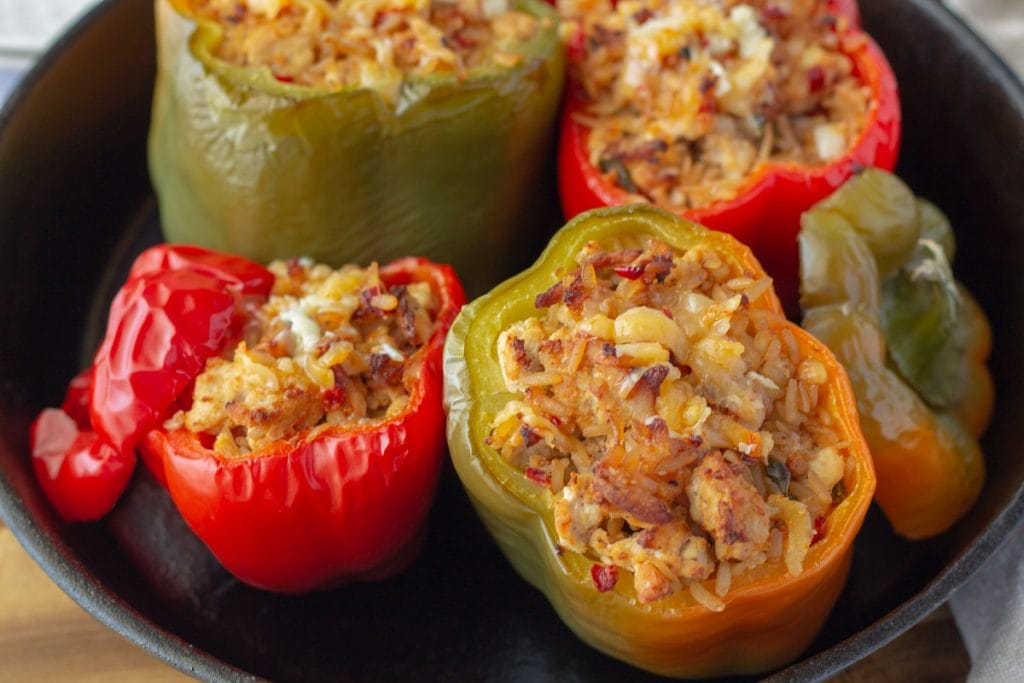 Easy Cheesy Stuffed Peppers in a cast iron skillet